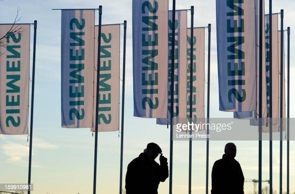 Shareholders arrive for the Siemens annual general shareholders' meeting at the Olympiahalle on January 23 2013 in Munich Germany Siemens announces...