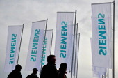 Shareholders arrive for the Siemens annual general shareholders' meeting at Olympiahalle on January 28 2014 in Munich Germany