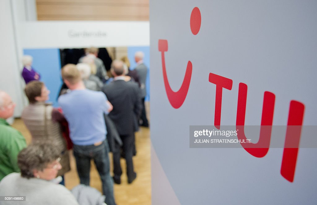 Shareholders arrive to attend the annual general meeting of the world's biggest tourism group TUI in Hanover, central Germany, on February 9, 2016. TUI said that it seen bookings to Turkey drop by 40 percent in the wake of the Istanbul attack, but hopes to meet its 2016 goals nevertheless. / AFP / dpa / Julian Stratenschulte / Germany OUT