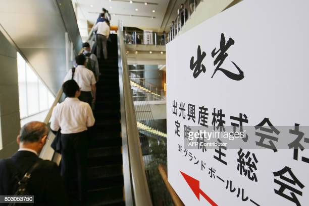 Shareholders arrive to attend the annual shareholders' meeting of Japan's Idemitsu Kosan oil company in Tokyo on June 29 2017 Some 1000...