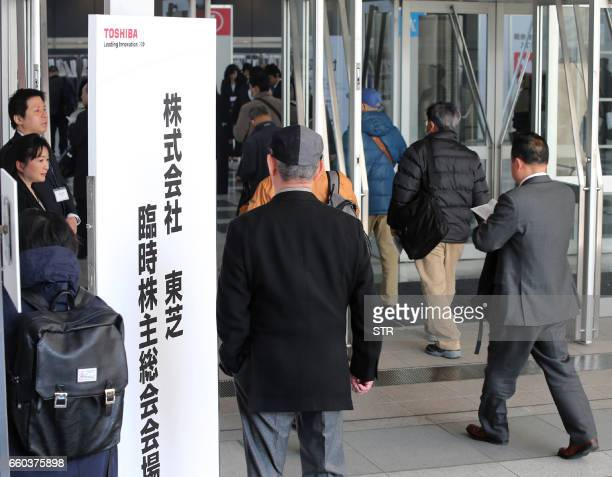 Shareholders arrive to attend the Toshiba shareholders meeting in Chiba on March 30 2017 The Japanese conglomerate held a shareholder meeting on...