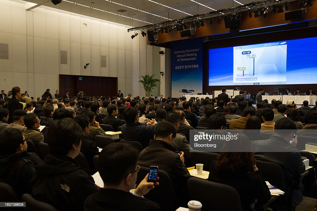 Shareholders attend the Samsung Electronics Co. annual general meeting at the company's Seocho office building in Seoul, South Korea, on Friday, March 15, 2013. Samsung Electronics's President of visual display Yoon Boo Keun and President of mobile communications J.K. Shin were appointed as co-chief executive officers following the meeting today, joining Vice Chairman Kwon Oh Hyun, who will also retain his position as co-CEO. Photographer: SeongJoon Cho/Bloomberg via Getty Images
