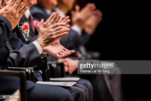 Shareholders clapping hands on positive report
