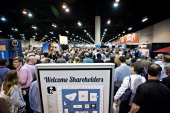 Shareholders crowd the exhibition floor during the Berkshire Hathaway shareholders meeting in Omaha Nebraska US on Saturday May 3 2014 Yesterday...