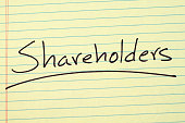 "The word ""Shareholders"" underlined on a yellow legal pad"