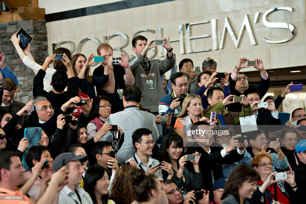 Shareholders try to get a photograph of Warren Buffett chairman of Berkshire Hathaway Inc during a shareholder event on the sidelines of the...