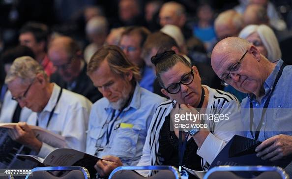 Shareholders wait for the start of the BHP Billiton annual general meeting in Perth on November 19 2015 BHP Chairman jac Nasser told shareholders the...