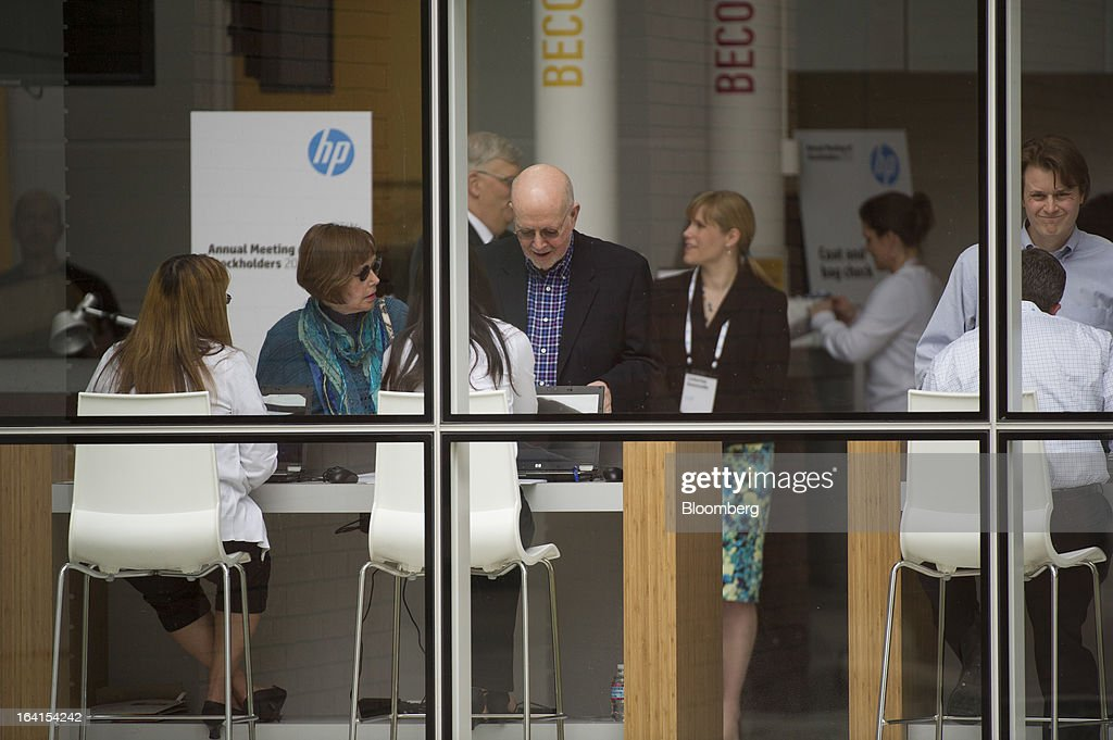Shareholders wait for the start of the Hewlett-Packard Co. annual meeting in Mountain View, California, U.S., on Wednesday, March 20, 2013. Hewlett-Packard Co. investors will get the chance to voice dismay over the $8.8 billion writedown of Autonomy Corp. when they're asked to re-elect Chairman Ray Lane and other directors at an annual meeting today. Photographer: David Paul Morris/Bloomberg via Getty Images