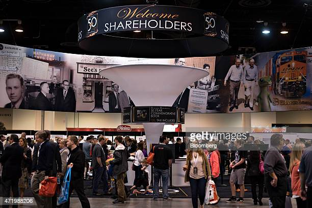 Shareholders walk on the exhibition floor during the Berkshire Hathaway Inc annual shareholders meeting in Omaha Nebraska US on Saturday May 2 2015...