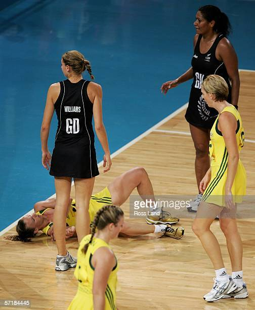 Sharelle McMahon of Australia lies injuries on the court during the gold medal netball match between Australia and New Zealand at the State Netball...