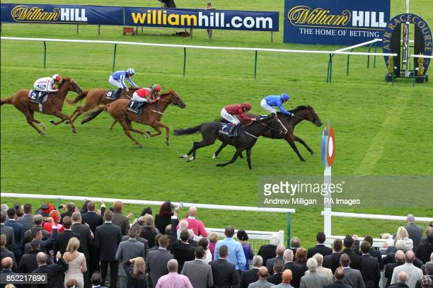 Sharestan ridden by Kieren Fallon wins The William HillBet On The Move Doonside Cup Stakes during day three of the William Hill Ayr Gold Cup Festival...