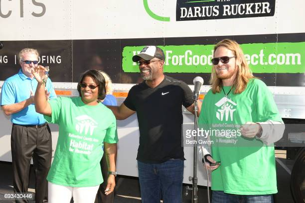 Shari Hinton Darius Rucker and Charles Russell show off their new keys at Ply Gem's Home for Good press conference with Habitat for Humanity on June...