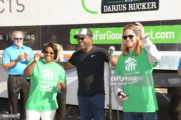 Shari Hinton Darius Rucker and Charles Russell show off their new keys to thier new homes Ply Gem's Home for Good press conference with Habitat for...
