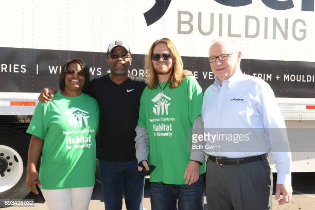 Shari Hinton Darius Rucker Charles Russell and Chairman and CEO of Ply Gem Gary E Robinette at Ply Gem's Home for Good press conference with Habitat...