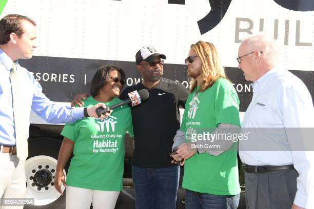 Shari Hinton Darius Rucker Charles Russell and Chairman and CEO of Ply Gem Gary E Robinette talk to press at Ply Gem's Home for Good press conference...