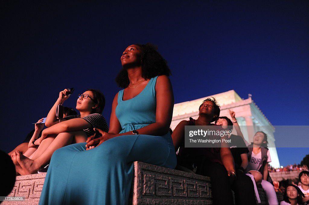 Shari Lewis and her mother Loriann Lewis (at her right) enjoy the fireworks from a perch in front of the Lincoln Memorial. They are visiting from Granada.Tens of thousands came to the National Mall tonight for the annual fireworks extravaganza. Photo by Michael S. Williamson/The Washington Post via Getty Images