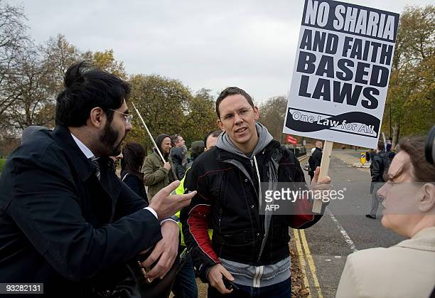 A Sharia Law supporter argues with a demonstrator at an antiSharia law demonstration in Hyde Park central London on November 21 2009 The organisers...