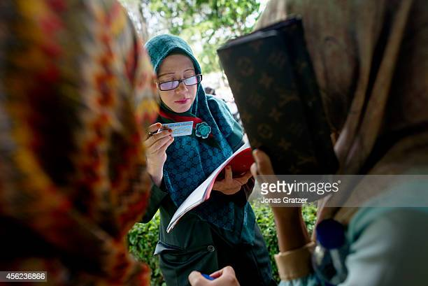 Sharia Police stop two young women who are wearing tights which goes against the prevailing Sharia Law in Banda Aceh Sharia Police take down their...