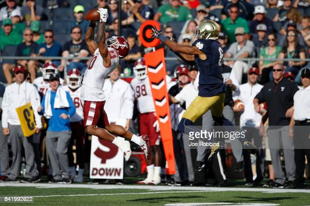 Sharif Finch of the Temple Owls intercepts a pass against the Notre Dame Fighting Irish in the third quarter of a game at Notre Dame Stadium on...