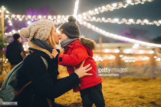 Sharing a kiss on Christmas market