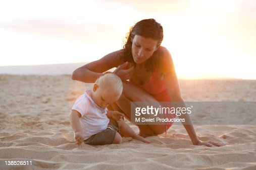 Sharing mother and boy : Stock Photo