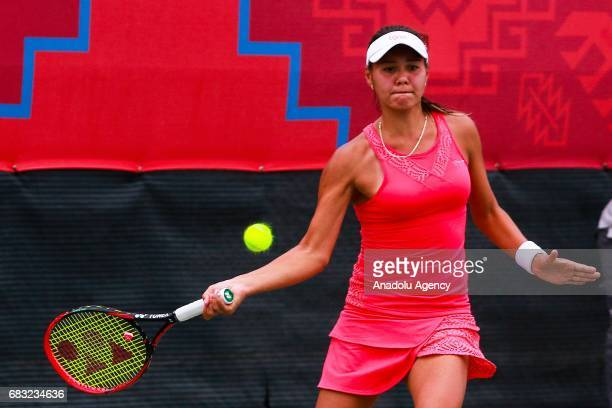 Sharipova Sabina of Uzbekistan in action against Eraydin Basak of Turkey during the Baku 2017 4th Islamic Solidarity Games women's final tennis match...