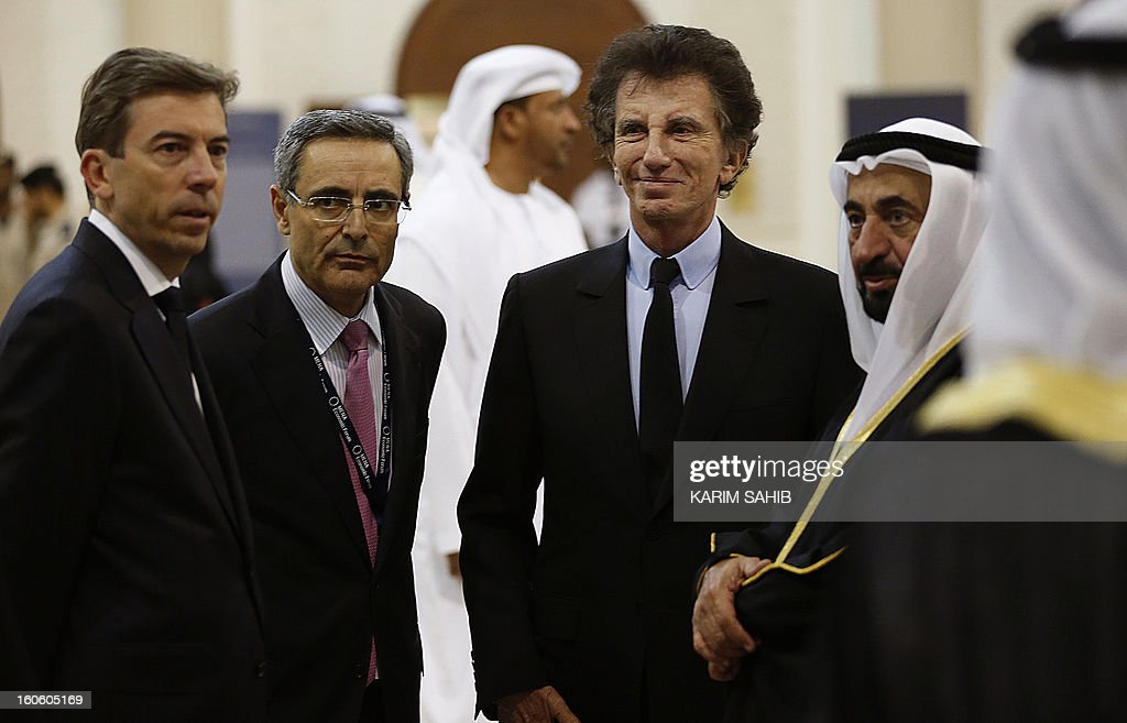 Sharjah ruler Sheikh Sultan bin Mohammad al-Qassimi (R), French ambassador to UAE Alain Azouaou (2nd-L) and Jack Lang (C), France's former culture minister and new president of the Arab World Institute (AWI) in Paris, attend the MENA Economic Forum at the American University of Sharjah (AUS) in the Gulf emirate on February 3, 2013. AFP PHOTO/KARIM SAHIB