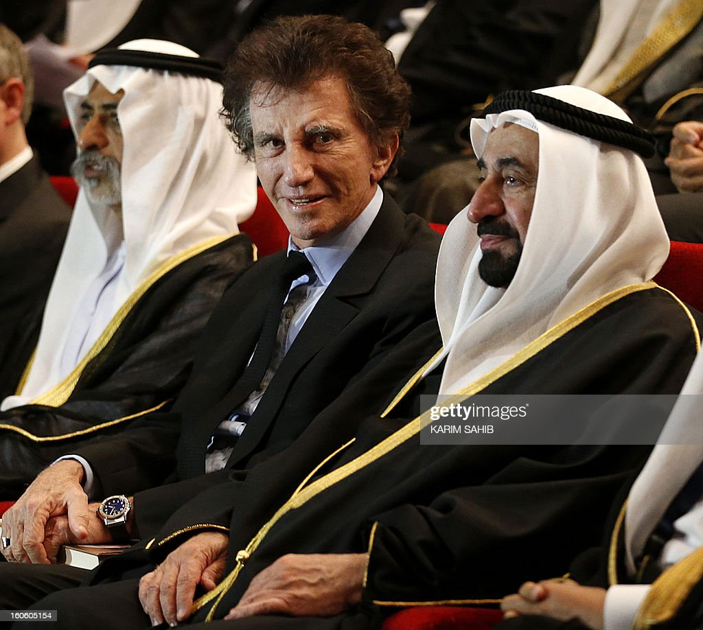 Sharjah ruler Sheikh Sultan bin Mohammad al-Qassimi (R) sits next to Jack Lang, France's former culture minister and new president of the Arab World Institute (AWI) in Paris, during the MENA Economic Forum at the American University of Sharjah (AUS) in the Gulf emirate on February 3, 2013.