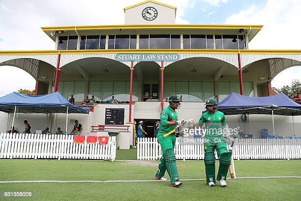 Sharjeel Khan and Asad Shafiq of Pakistan walk out for the start of the tour match between Pakistan and the CA XI at Allan Border Field on January 10...
