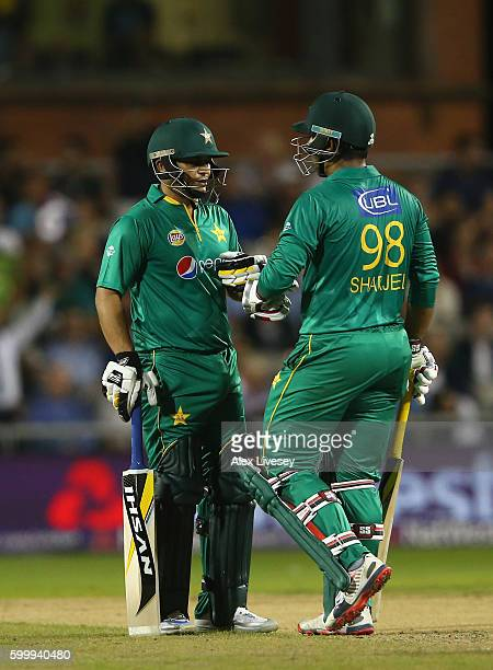 Sharjeel Khan and Khalid Latif of Pakistan touch gloves as they talk during the NatWest International T20 match between England and Pakistan at Old...