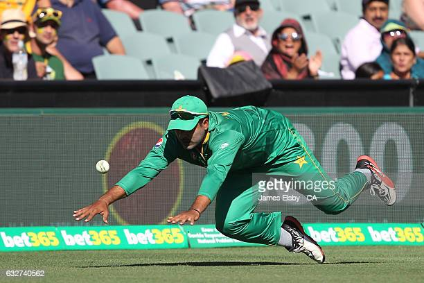 Sharjeel Khan of Pakistan dives for the ball during game five of the One Day International series between Australia and Pakistan at Adelaide Oval on...