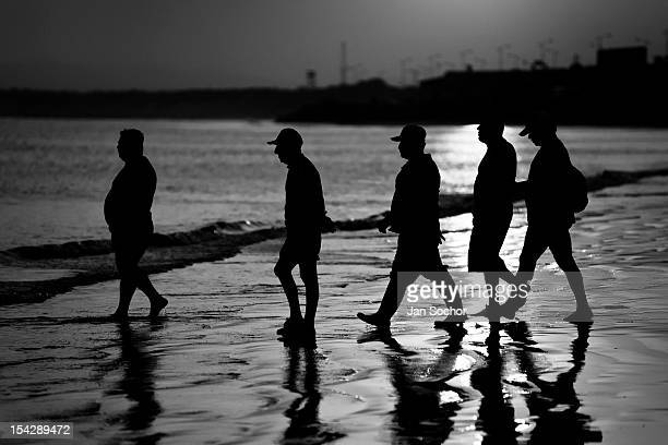 Shark fin buyers wait for fishermen at dawn on the beach on 9 September 2012 in Manta Ecuador Every morning hundreds of shark bodies and thousands of...