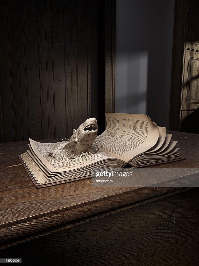 Shark popping up from an old book : Stock Photo