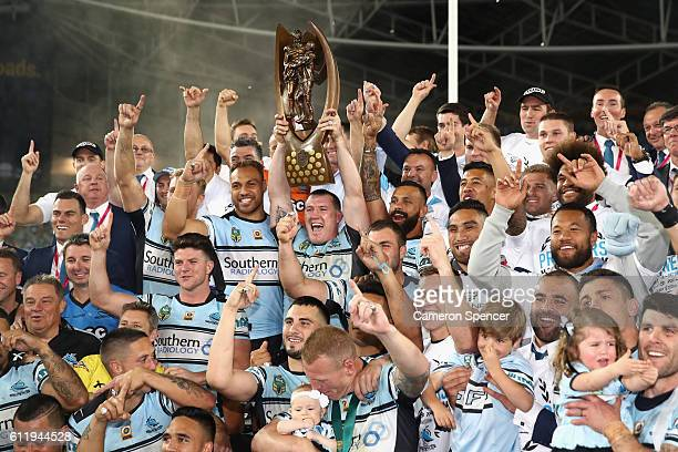 Sharks captain Paul Gallen and team mates celebrate with the ProvanSummons Trophy after winning the 2016 NRL Grand Final match between the Cronulla...