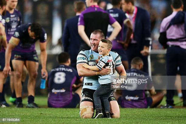 Sharks captain Paul Gallen celebrates with his son Cody Gallen after victory in the 2016 NRL Grand Final match between the Cronulla Sharks and the...