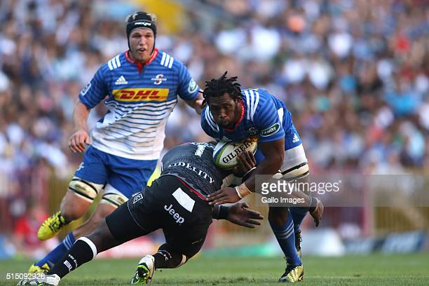 Sharks captain Tendai Mtawarira tackles Siya Kolisi of the Stormers during the 2016 Super Rugby match between DHL Stormers and Cell C Sharks at DHL...