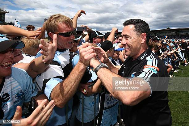 Sharks coach Shane Flanagan celebrates with fans during the Cronulla Sharks NRL Grand Final celebrations at Southern Cross Group Stadium on October 3...
