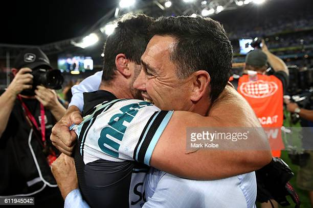 Sharks coach Shane Flanagan celebrates with Michael Ennis of the Sharks after winning the 2016 NRL Grand Final match between the Cronulla Sharks and...