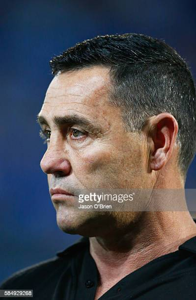 Sharks coach Shane Flanagan looks on during the round 21 NRL match between the Gold Coast Titans and the Cronulla Sharks at Cbus Super Stadium on...