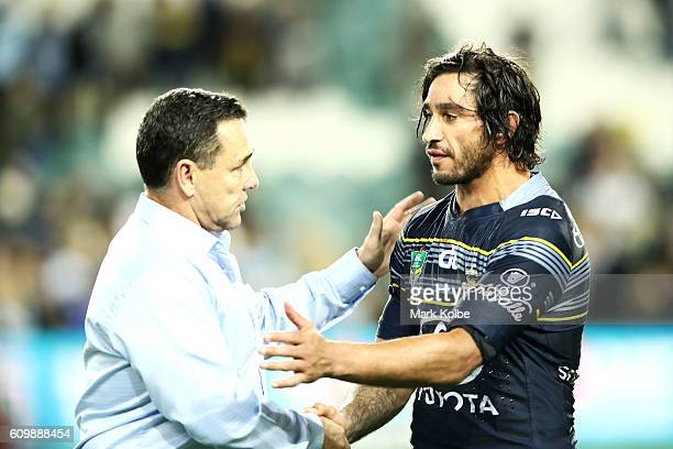 Sharks coach Shane Flanagan shakes hands with Cowboys captain Johnathan Thurston following the NRL Preliminary Final match between the Cronulla...