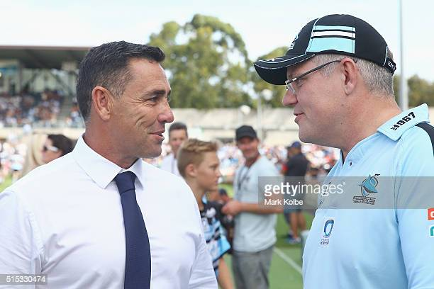 Sharks coach Shane Flanagan speaks to Australian politician Scott Morrison MP is interviewed before the round two NRL match between the Cronulla...