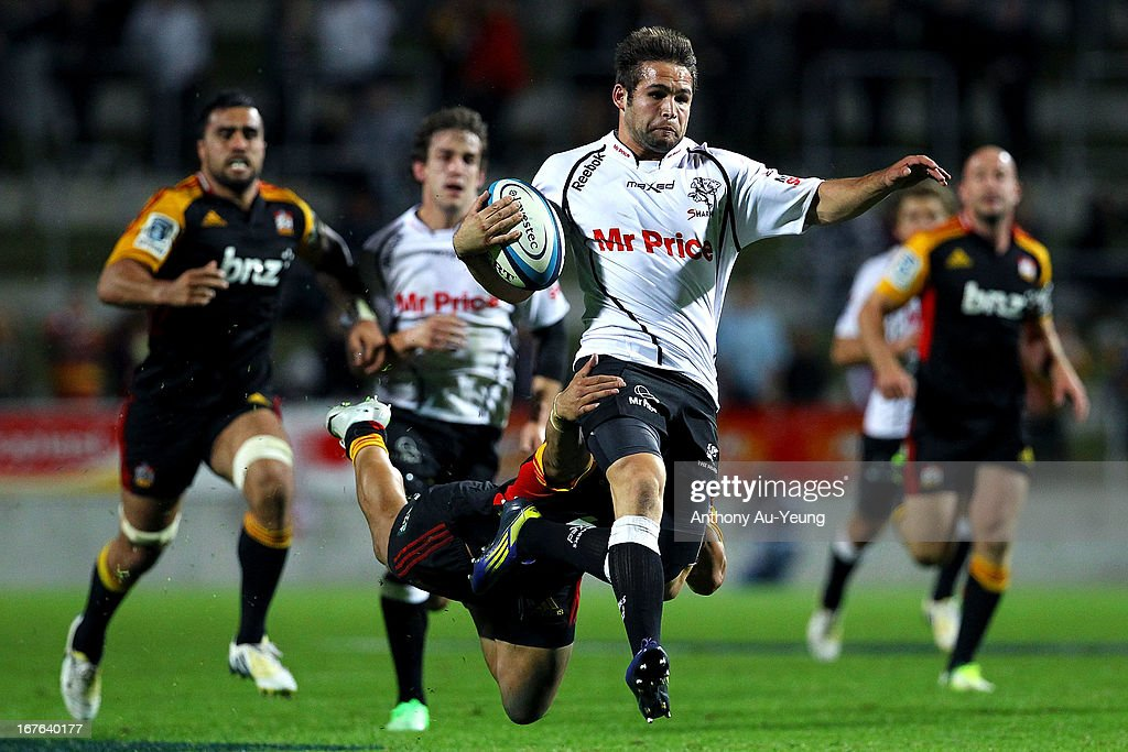 Sharks' Cobus Reinach is tackled by Chiefs' <a gi-track='captionPersonalityLinkClicked' href=/galleries/search?phrase=Tim+Nanai-Williams&family=editorial&specificpeople=5476637 ng-click='$event.stopPropagation()'>Tim Nanai-Williams</a> on the break during the round 11 Super Rugby match between the Chiefs and the Sharks at Waikato Stadium on April 27, 2013 in Hamilton, New Zealand.
