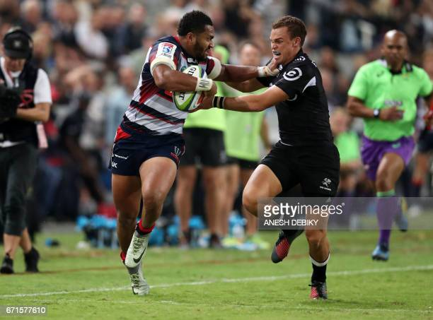 Sharks' Curwin Bosch tackles Rebels Sefa Naivalu during the Super XV rugby union match between Sharks and Rebels at Kingspark rugby stadium on April...