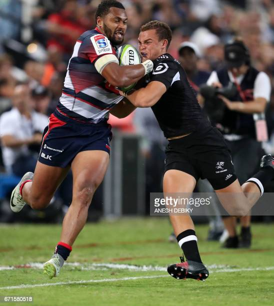 Sharks Curwin Bosch tackles Rebels Sefa Naivalu during the Super XV rugby union match between Sharks and Rebels at Kingspark rugby stadium on April...