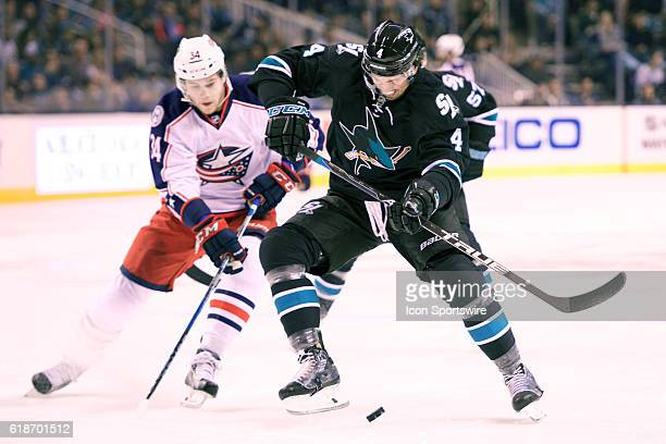 Sharks defenseman Brenden Dillon holds off Blue Jackets right wing Josh Anderson during the NHL game between the San Jose Sharks and the Columbus...