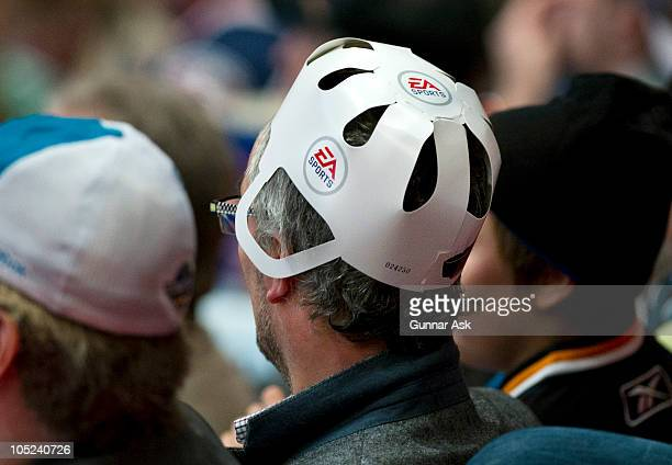 Sharks fan in the stands with EA Sports helmet during the 2010 Compuware NHL Premiere game between San Jose Sharks and Columbus Blue Jackets at the...