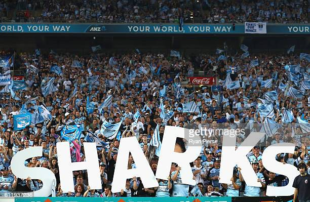 Sharks fans cheer during the 2016 NRL Grand Final match between the Cronulla Sutherland Sharks and the Melbourne Storm at ANZ Stadium on October 2...