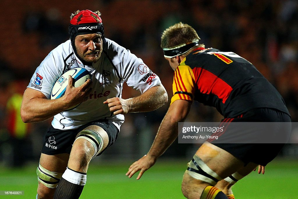 Sharks' Franco van der Merwe charges at Chiefs' Sam Cane during the round 11 Super Rugby match between the Chiefs and the Sharks at Waikato Stadium on April 27, 2013 in Hamilton, New Zealand.