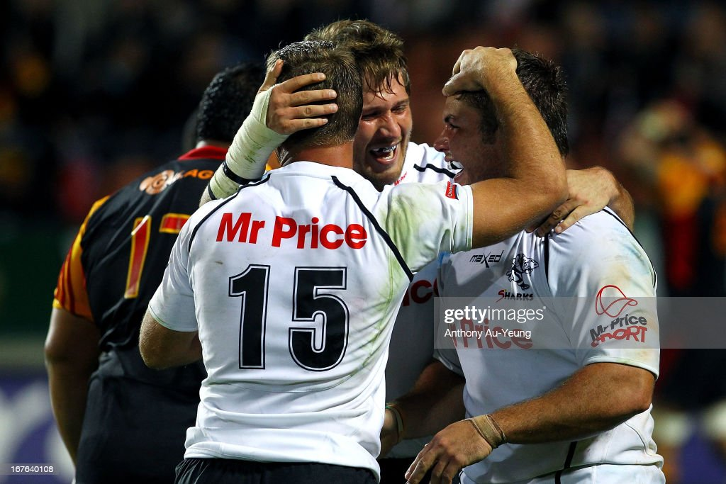 Sharks' <a gi-track='captionPersonalityLinkClicked' href=/galleries/search?phrase=Francois+Steyn&family=editorial&specificpeople=684108 ng-click='$event.stopPropagation()'>Francois Steyn</a> celebrates with teammates Wiehahn Herbst and Riaan Viljoen for their team's try during the round 11 Super Rugby match between the Chiefs and the Sharks at Waikato Stadium on April 27, 2013 in Hamilton, New Zealand.