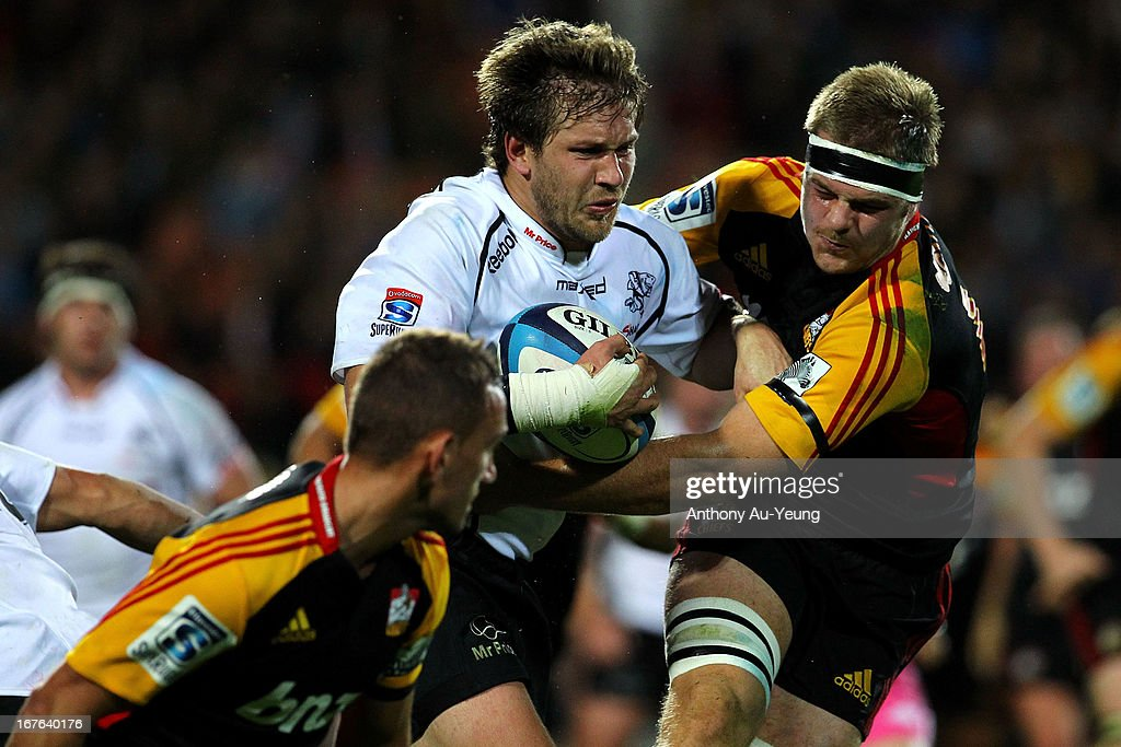 Sharks' <a gi-track='captionPersonalityLinkClicked' href=/galleries/search?phrase=Francois+Steyn&family=editorial&specificpeople=684108 ng-click='$event.stopPropagation()'>Francois Steyn</a> runs into Chiefs' Sam Cane during the round 11 Super Rugby match between the Chiefs and the Sharks at Waikato Stadium on April 27, 2013 in Hamilton, New Zealand.